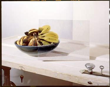 Bananas in bowl with painting on door 2012
